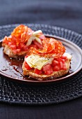 Artichoke,chorizo and tomato open sandwich