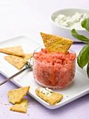 Tomato granita and sesame seed crackers