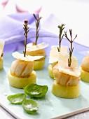 Potato, saffron-flavored scallops, rosemary and parmesan bites