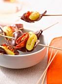 Gnocchi, sun-dried tomato and duck magret mini brochettes