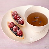 Chocolate-raspberry tartlets and a cup of tea