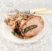 Marinated leg of lamb stuffed with herbs