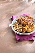 Spicy shoulder of lamb cooked with honey, sauteed potatoes and artichokes with thyme