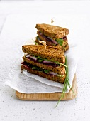 Herring, beetroot and avocado brown bread sandwich