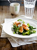 Steamed salmon with green vegetables, yoghurt and herb sauce
