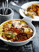 Pasta, lamb and tomato gratin