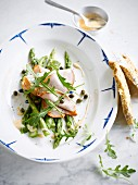 Green asparagus and caper salad with cold sliced roast pork