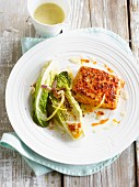 Thick piece of salmon with paprika, grilled Sucrine with lemon and garlic