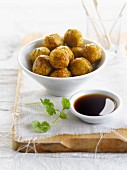 Chicken and herb meatballs with soya sauce