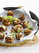 Button mushrooms stuffed with diced yellow peppers, cream of blue cheese and fennel