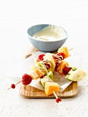Mixed summer fruit brochettes with white chocolate sauce