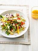 Pepper,cherry tomato,radish,apple and dried fruit mixed salad
