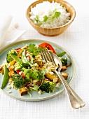Sauteed rice with tofu,broccolis and sugar peas