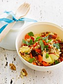 Rice, apple, carrot and dried fruit salad