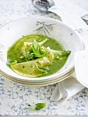 Raviolis in basil sauce