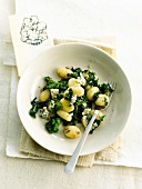 Gnocchis with roquefort and broccoli leaves