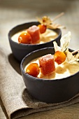 Vanilla custard with apples roasted with ginger,fruit paste and caramelized physalis brochette