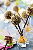 Dark chocolate ganache and crushed shortbread cookie lollipops on Mikado sticks