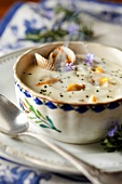 Cream of cauliflower soup with cockles