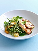 Grilled chicken breasts,very thin strips of cucumber and yellow cherry tomatoes