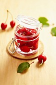 Jar of cherries pickled in vinaigar