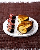 Prunes wrapped in bacon, salty spicy roasted bananas