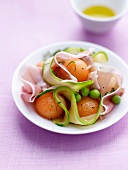 Thin strips of zucchinis,melon ball and Aoste ham salad