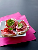 Cream cheese,dried ham and sliced radishes on toast