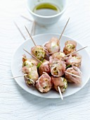 Small mozzarella balls with crushed pistachios and wrapped in Aoste ham