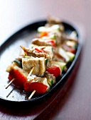 Pan-fried tofu and artichoke heart brochettes with soya sauce
