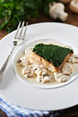 Pollock coated with creamed spinach, button mushroom creamy sauce