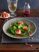 Corn lettuce with caramelized scallops with pomegranate seeds