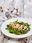 Sliced chicken breast with tapenade, rocket lettuce and mushrooms in mango vinaigrette
