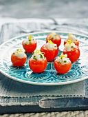 Cherry tomatoes stuffed with fish tartare