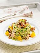 Zucchini and radish tartare with sauteed small squid and orange