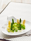 White and gren asparagus tops with steamed leeks and creamy citrus fruit sauce
