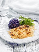 Potato gratin with red cabbage and rocket lettuce