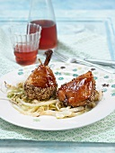 Chicken glazed in honey with black and golden sesame seeds, braised cabbage