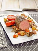 Oven-cooked veal roast with vegetables