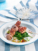 Octopus and sausage meat ball brochettes with spinach