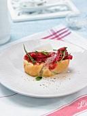 Veal carpaccio, parmesan and rocket lettuce canapé