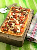 Fresh and sun-dried tomato and cheese pizza