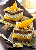 Chocolate sponge cake with orange curd, whipped cream and green tea