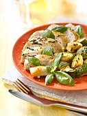 Pan-fried chicken breasts, zucchini and basil