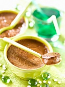 Small pots of dark chocolate cream dessert