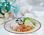 Three types of fish in crayfish sauce with mixed white and wild rice