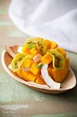 Mango, kiwi and coconut fruit salad