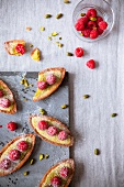 Pistachio and raspberry boat-shaped tartlets