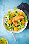 Corn lettuce,baby spinach,chicken and melon ball salad
