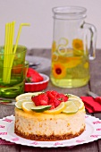 Lemon-lime cheesecake topped with strawberries